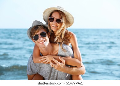 Happy couple on sea background