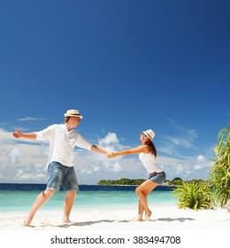Happy couple on the tropical beach