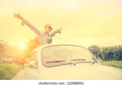 happy couple on vintage car. concept of carefree and freedom