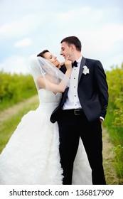 Happy couple on wedding day, summertime
