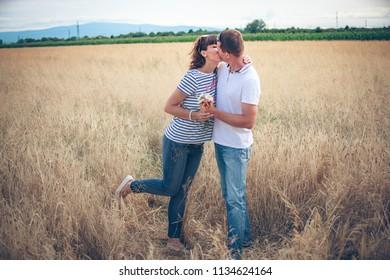 Happy couple on wheat field