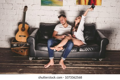 Happy couple playing video games on console and having fun.