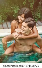 Happy couple in pool