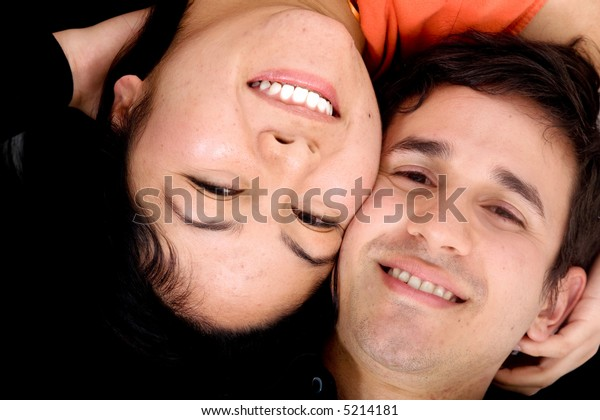 happy couple portrait with heads together on the floor
