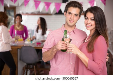 Happy couple portrait at home event with friends and family anniversary engagement proposal party