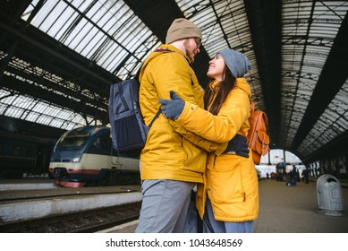happy couple at railway station. meet after long time no see each other