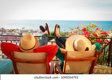 happy couple relax on balcony terrace