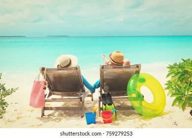 happy couple relax on a tropical beach