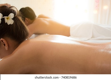 Happy couple in relaxing spa massage.