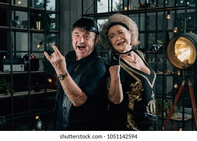 Happy couple of retirees in biker clothes.Unusual retired couple.Biker man and biker woman.Happy pensioners