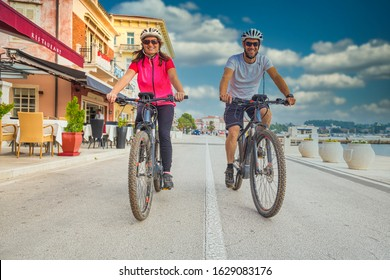 Happy couple riding an E-Bike during vacations