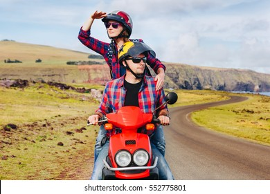 Happy Couple riding a motorbike. Young hipster riders enjoying the trip. Adventure and vacations concept