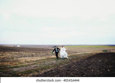 Happy couple is running away