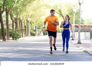 happy couple running on the park