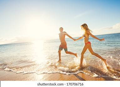 Happy Couple Running on Tropical Beach at Sunset, Vacation