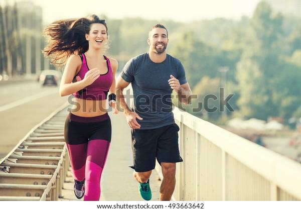 Happy Couple Running Over Bridge Living Stock Photo Edit