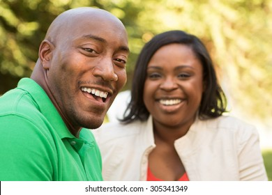 Happy couple. Selective focus on the African American man.