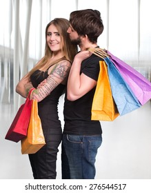 Happy couple with shopping bags at the mall