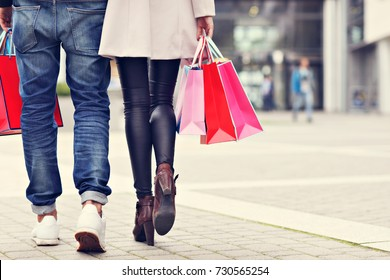 Happy couple shopping in the city
