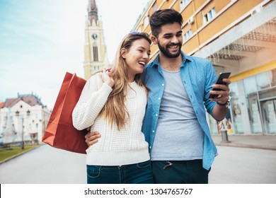 Happy couple shopping together and having fun.