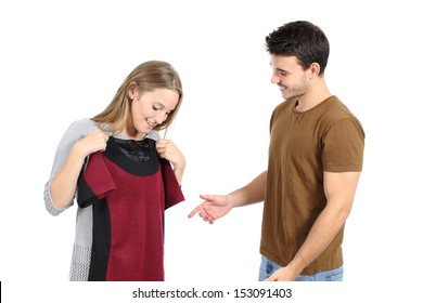 Happy couple shopping and trying clothes isolated on a white background