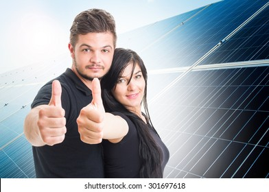Happy couple showing like on solar power photovoltaic panel background  as green energy solution concept