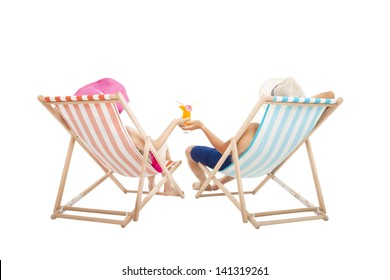 happy Couple sitting on  beach chairs and holding orange juice