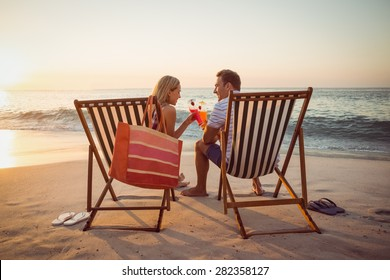 happy couple smiling at the beach