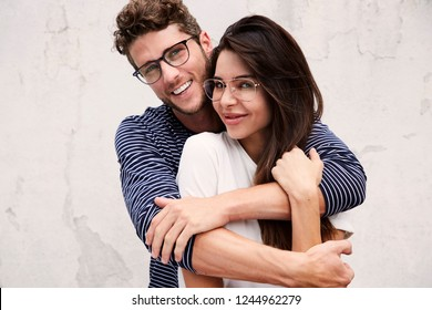 Happy couple smiling in glasses, portrait