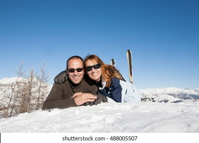 happy couple in the snow in the sun