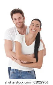 Happy couple standing over white background, laughing.?