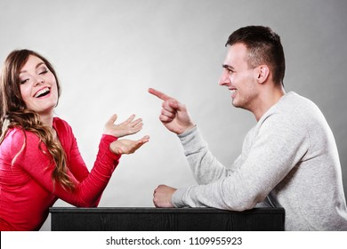 Happy couple talking and laughing on date. Smiling girl and guy having conversation. Amusing man making woman laugh. Good relationship.