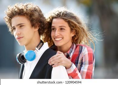 Happy couple of teenagers