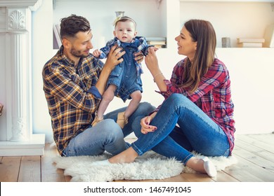 happy couple and their cute baby daughter at home