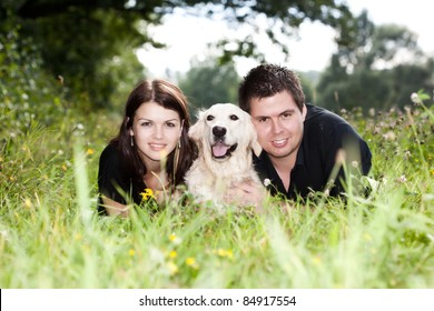 Happy Couple With Their Puppy