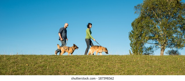 happy couple with their two dogs