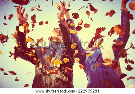 Happy  couple throwing  autumn fall leaves