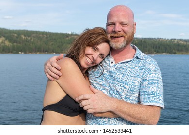 Happy couple together on a lake