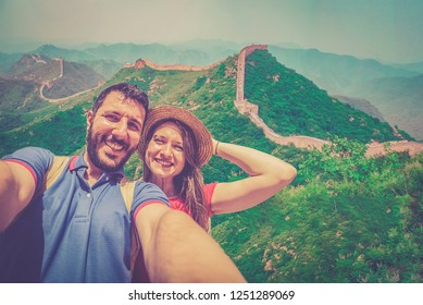 Happy couple tourists taking selfie photo at Great wall of China, traveling in Beijing and Shangai