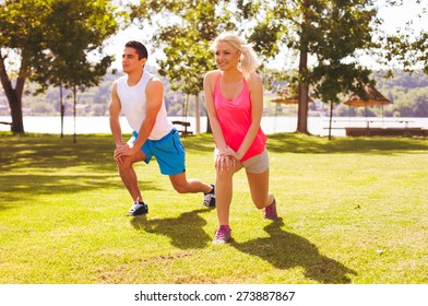 Happy couple training in the park