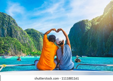 Happy couple traveler doing heart shape joy relaxing on boat Maya beach, Krabi Phuket, Travel adventure nature Thailand, Tourist beautiful destination place Asia, Summer holiday outdoor vacation trip