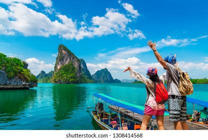 Happy couple traveler joy fun beautiful nature scenic landscape Phang-Nga bay, Adventure landmark travel Phuket Thailand, Tourist people on summer holiday vacation trip, Tourism destination place Asia