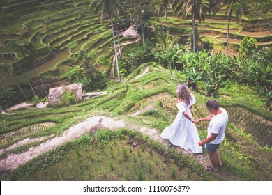 Happy couple traveling at Bali, rice terraces of Tegalalang, Ubud. Honeymoon summer travel at Indonesia. Happy people.