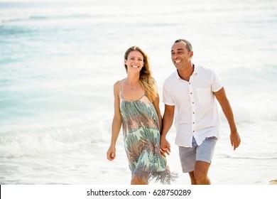 Happy Couple Walking on Seaside on Vacation
