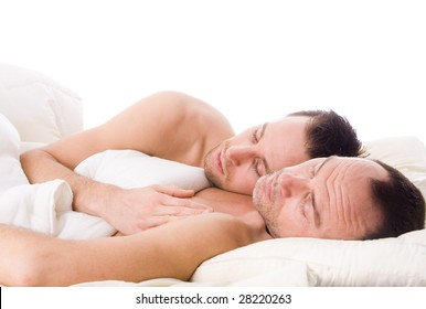 Happy couple in a white bed taking care of his boyfriend