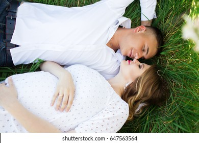 Happy couple woman and man lying on grass