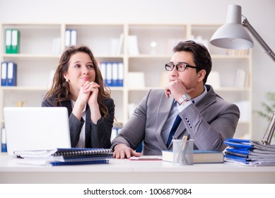 Happy couple working in the same office