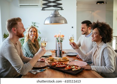 Happy couples enjoying a romantic lunch at home.
