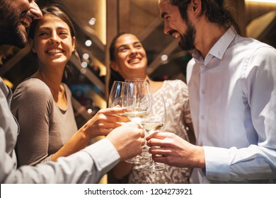 Happy couples taste wine in the restaurant