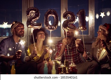 Happy couples waiting for New Year at home party in festive atmosphere. New Year, home party, friends time together